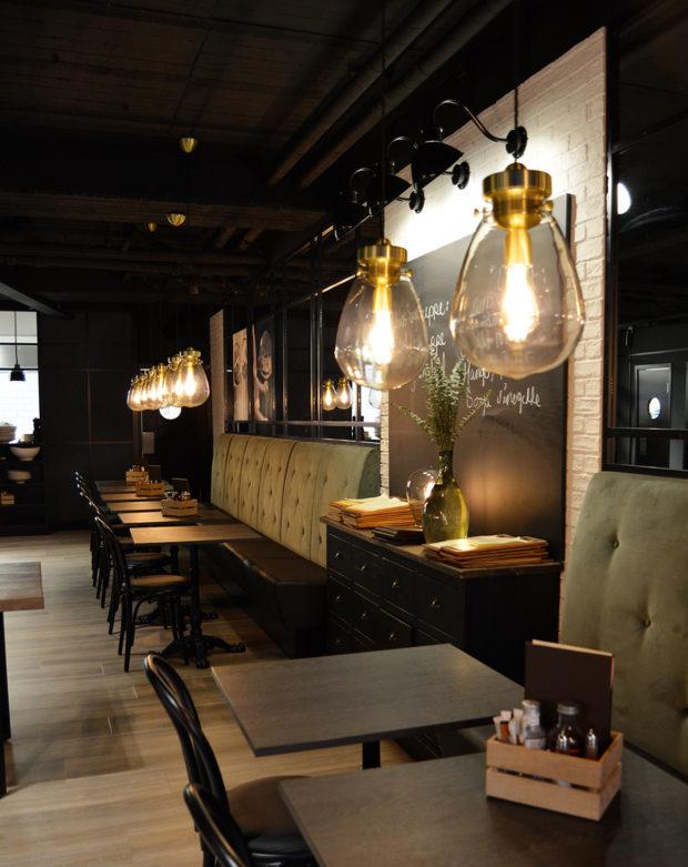 Mørk og lunt interiør hos Condelica av AD Arkitekter.